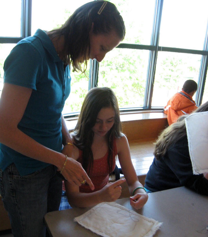 Laura Sapelly and middle school student quilting
